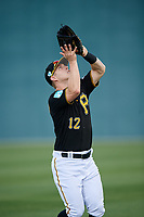 Pittsburgh Pirates outfielder Corey Dickerson (12) settles under a fly ball during the teams first Spring Training practice on February 18, 2019 at Pirate City in Bradenton, Florida.  (Mike Janes/Four Seam Images)