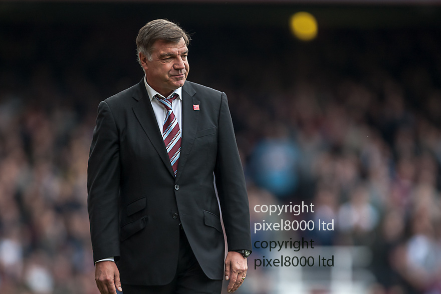 London, UK. A little smile from West Ham manager as his side go 1-0 up during nPower Championship playoff semi final second leg fixture West Ham United versus Cardiff City at Upton Park Boleyn Ground 07 May.  Please Byline David Fearn Pixel 8000 Ltd