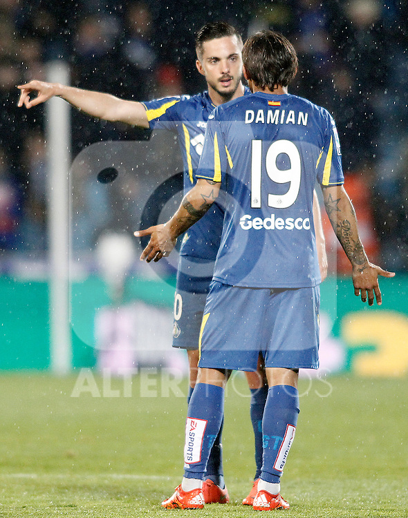 Getafe's Pablo Sarabia (f) and Damian Suarez during La Liga match. March 18,2016. (ALTERPHOTOS/Acero)