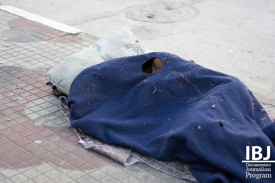 A homeless man in Sao Paulo sleeps in a blanket with a hole for air. This man was sleeping a few steps away from a police outpost. In wintertime, the weather gets very warm during the day but temperatures do plummet late at night. Sao Paulo is a growing city with nearly 18 million in the metropolitan area. Although homelessness and poverty are huge problems the city maintains its attractiveness for the economic opportunities it affords to residents. IBJ will be initiating a defense lawyer training program in and around Sao Paulo.