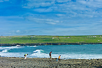 Family group searching rockpools at Doolin, County Clare, West Coast of Ireland