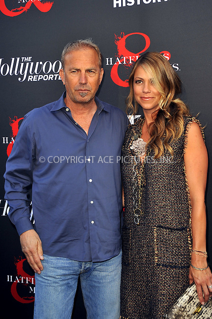 WWW.ACEPIXS.COM . . . . .  ....May 21 2012, LA....Actor Kevin Costner and Christine Costner at a special screening of 'Hatfields & McCoys' hosted by The History Channel at Milk Studios on May 21, 2012 in Hollywood, California. ....Please byline: PETER WEST - ACE PICTURES.... *** ***..Ace Pictures, Inc:  ..Philip Vaughan (212) 243-8787 or (646) 769 0430..e-mail: info@acepixs.com..web: http://www.acepixs.com