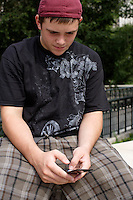 Nic Taylor sends a text message from Millennium Park in Chicago, Illinois on August 5, 2008.