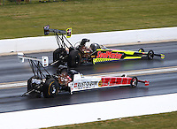 Jul 10, 2016; Joliet, IL, USA; NHRA top fuel driver T.J. Zizzo (near) races alongside J.R. Todd during the Route 66 Nationals at Route 66 Raceway. Mandatory Credit: Mark J. Rebilas-USA TODAY Sports