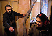 A poor man asks his elderly neighbour to sit with him at home in Oryol, a poor city in the heart of Russia.