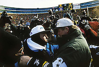 "Carolina Panthers Coach Dom Capers and Green Bay Packers Coach Mike Holmgren meet at mid-field after the Packers defeated the Panthers 30-13 in the NFC Championship game at Lambeau Field on January 12, 1997. This was the first title game in Green Bay since the ""Ice Bowl"" in 1967."