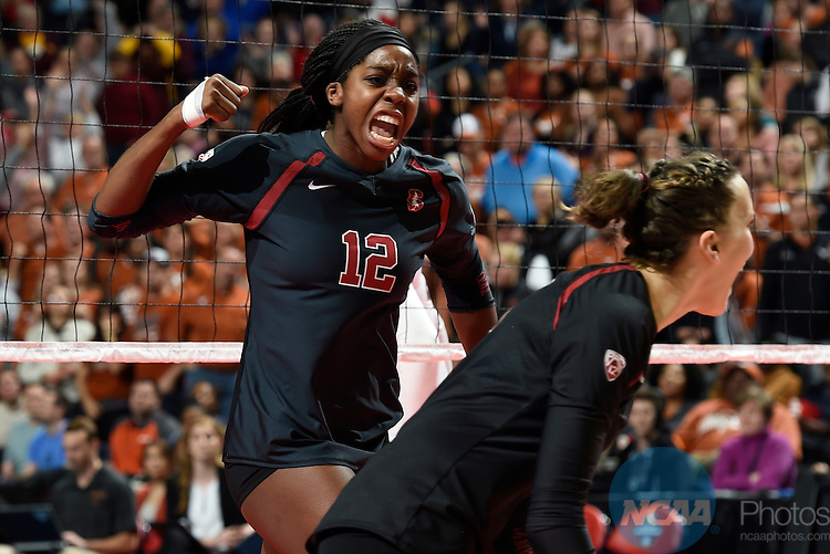 COLUMBUS, OH - DECEMBER 17: Inky Ajanaku (12) of Stanford University celebrates a point against the University of Texas during the Division I Women's Volleyball Championship held at Nationwide Arena on December 17, 2016 in Columbus, Ohio.  Stanford defeated Texas 3-1 to win the national title. (Photo by Jamie Schwaberow/NCAA Photos via Getty Images)