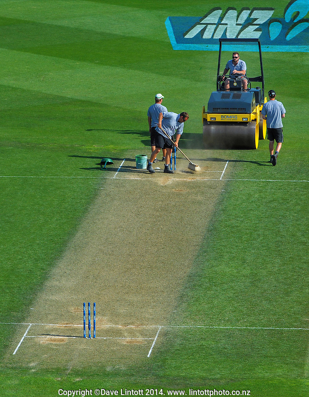 Ground staff attend the the wicket during day two of the 2nd cricket test match between the New Zealand Black Caps and Sri Lanka at the Hawkins Basin Reserve, Wellington, New Zealand on Sunday, 4 February 2015. Photo: Dave Lintott / lintottphoto.co.nz
