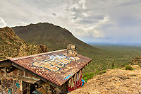 Gates Pass in the Tucson Mountains west of Tucson, Arizona is a perfect example of the collision between nature and civilization as the urban blight of trash and graffiti mar the beautiful landscapes that abound.