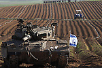 An Israeli tank is seen in a field outside Gaza. In the first major clash since the cease fire, Hamas militants detonated a bomb near an Israeli jeep killing one soldier, to which the IDF has responded with aerial attacks in Gaza.<br /> Photo By: Eliyahu Ben Igal / JINI
