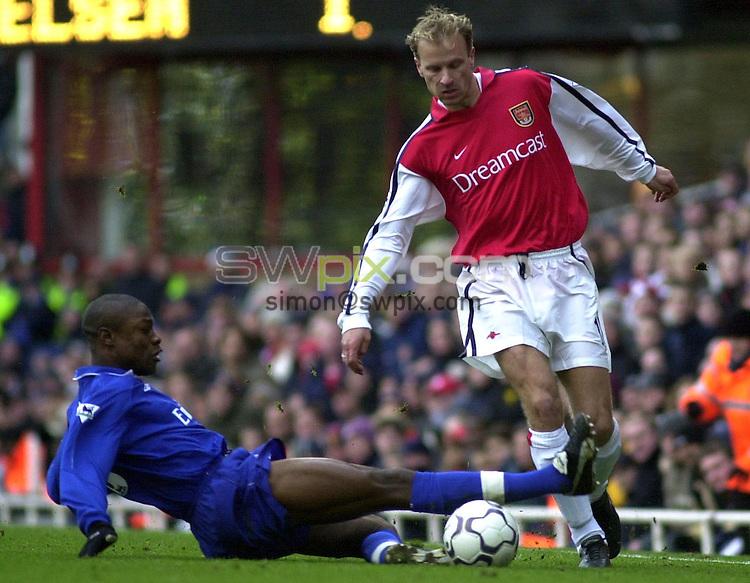 Pix: Dave Winter/SWpix.com. Soccer. FA Barclaycard Premiership. Arsenal v Chelsea. 12/02/2002...COPYWRIGHT PICTURE>>SIMON WILKINSON>>01943 436649>>..Arsenal's Dennis Bergkamp beats Chelsea's tackle from William Gallas.