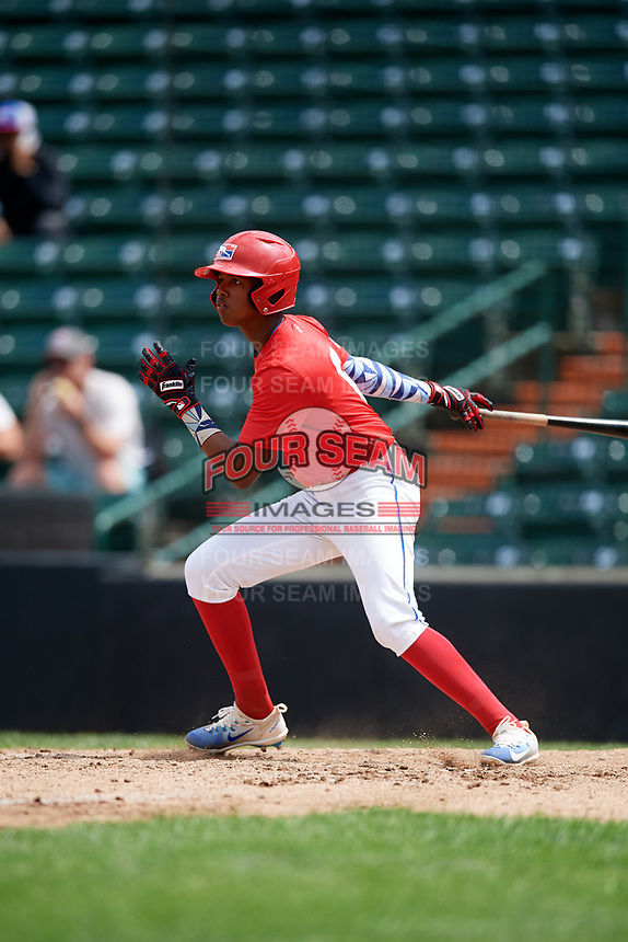 Luis Ravelo (6) follows through on a swing during the Dominican Prospect League Elite Underclass International Series, powered by Baseball Factory, on July 21, 2018 at Schaumburg Boomers Stadium in Schaumburg, Illinois.  (Mike Janes/Four Seam Images)