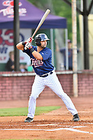 Elizabethton Twins third baseman Alex Robles (24) swings at a pitch during a game against the Kingsport Mets at Joe O'Brien Field on August 7, 2018 in Elizabethton, Tennessee. The Twins defeated the Mets 16-10. (Tony Farlow/Four Seam Images)
