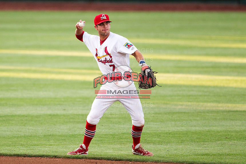 Greg Garcia (7) of the Springfield Cardinals throws to first base during a game against the Arkansas Travelers at Hammons Field on June 12, 2012 in Springfield, Missouri. (David Welker/Four Seam Images)