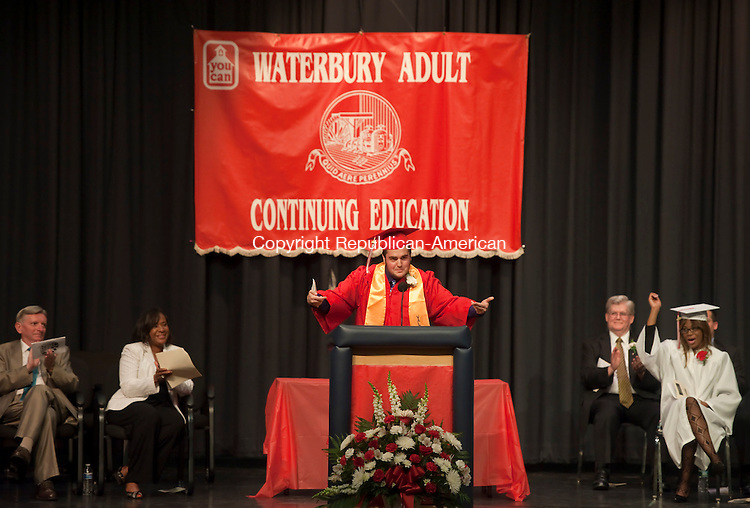 WATERBURY, CT-061314JS06--PM session Valedictorian Adam Landona, wishes all of the graduates all the best as he gives his address during Adult Education Graduation Friday at Kennedy High School in Waterbury. <br /> Jim Shannon Republican-American