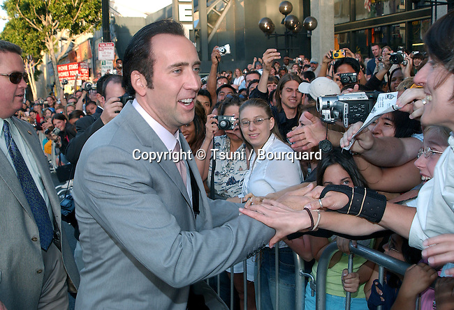 "Nicolas Cage signing autograph at the "" Windtalkers premiere""  at the Chinese Theatre in Los Angeles. June 11, 2002.           -            CageNicolas11.jpg"