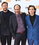 Armie Hammer, Luca Guadagnino and Timothee Chalamet attend the 'Call Me By Your Name' premiere during the 2017 Toronto International Film Festival at Ryerson Theatre on September 7, 2017 in Toronto, Canada.