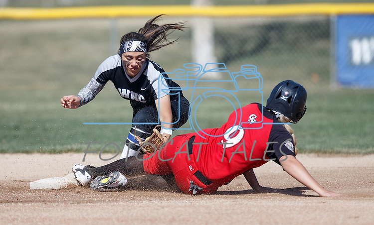 Western Nevada's Gabrielle Canibeyaz tags the runner against Colorado Northwestern at Edmonds Sports Complex Carson City, Nev., on Friday, March 18, 2016.<br /> Photo by Jeff Mulvihill, Jr./Nevada Photo Source