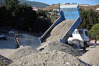 Pictured: A pile of soil is unloadedin Kos, Greece. Thursday 06 October 2016<br />