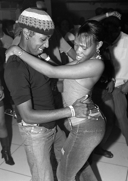 "KINGSTON, JAMAICA : Local youths dance at Kingston's hottest Dancehall nightclub "" Club Quad"". Located in New Kingston, Club Quad is a muli-level night club that hosts the best Dancehall Djs in town. Kingston, Jamaica, Eastern Caribbean."