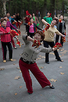 Chinese women dance as part of their morning exercise at Yangpu Park in Shanghai, China on November 7, 2009.