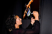 Valerie Vili signs a painting at the Counties Manukau Sport 17th annual Sporting Excellence Awards held at the Telstra Clear Pacific Events Centre, Manukau City, on November 27th 2008.