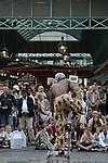 Street performer balancing chairs Covent Garden London UK