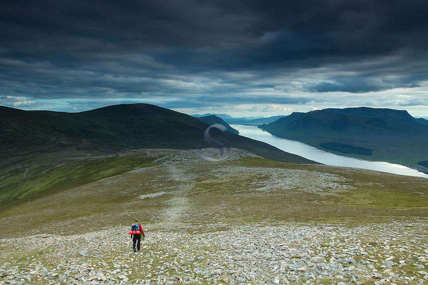 A walker descending the Munro of Geal Charn above the Drumochter Pass and Loch Ericht, Monadhliath, Cairngorm National Park, Highlands<br /> <br /> Copyright www.scottishhorizons.co.uk/Keith Fergus 2011 All Rights Reserved