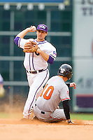 Connor Castellano #4 of the Texas Christian Horned Frogs attempts to turn a double play as Jake MacWilliam #10 of the Sam Houston State Bearkats slides into second base at Minute Maid Park on February 28, 2014 in Houston, Texas.  The Bearkats defeated the Horned Frogs 9-4.  (Brian Westerholt/Four Seam Images)