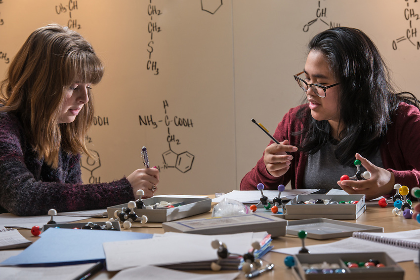 Chemistry A104 students Madi Willets, left, and Leslie Cajimat, right, work on a pre-lab exercise using molecular models in the Conoco Phillips Integrated Science Building.