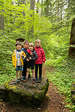 USA, Oregon, Santiam River, Brown Cannon, young boys pose for a photo in the Willamete National Forest before going out fishing