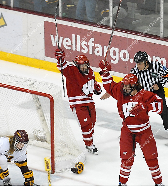 Jinelle Zaugg and Sara Bauer celebrate one of four Badger goals as Wisconsin tops the Minnesota Golden Gophers 4-1 Friday night, 1/5/06, at the Ridder Arena in Minneapolis