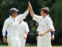 Keeling of Hornchurch Athletic (R) celebrates the wicket of P French - Hornchurch Athletic CC 3rd XI vs Noak Hill Taverners CC - Lords International Essex Cricket League at Hylands Park - 27/06/09- MANDATORY CREDIT: Gavin Ellis/TGSPHOTO - Self billing applies where appropriate - 0845 094 6026 - contact@tgsphoto.co.uk - NO UNPAID USE.