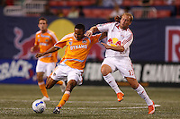 Red Bulls midfielder (13) Clint Mathis challenges Houston Dynamo midfielder (13) Ricardo Clark for the ball at Giants Stadium, East Rutherford, NJ, on April 21, 2007. The Red Bulls defeated the Dynamo 1-0.