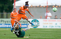 Sky Blue FC  forward Natasha Kai (6) jumps over the sliding Saint Louis Athletica defender Sara Larsson (4) during a WPS match at Anheuser-Busch Soccer Park, in St. Louis, MO, July 22, 2009. Athletica won the match 1-0.