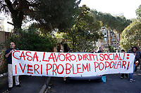 Banner: House, work and social rights, the real problems<br /> Rome April 6th 2019. Counterdemonstration of activists from the anti-fascist movements in the Torre Maura district of Rome, two days after Rome residents and neo-fascists burned bins and shouted racist slogans at Roma families being temporarily hosted in their neighbourhood. <br /> photo di Samantha Zucchi/Insidefoto
