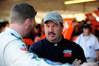 Nov. 7, 2008; Avondale, AZ, USA; Tony Eury Jr talks with NASCAR Sprint Cup Series driver Dale Earnhardt Jr during practice for the Checker Auto Parts 500 at Phoenix International Raceway. Mandatory Credit: Mark J. Rebilas-