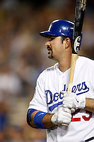 Adrian Gonzalez #23 of the Los Angeles Dodgers waits on deck before batting against the Colorado Rockies at Dodger Stadium on September 29, 2012 in Los Angeles, California. Los Angeles defeated Colorado 3-0. (Larry Goren/Four Seam Images)
