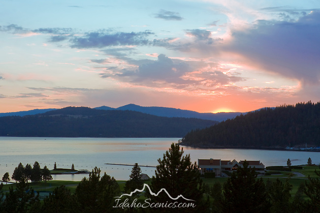 Sunset over Lake Coeur D Alene with Tubbs hill center right, and the floating green and Couer D Alene Resort Golf Course in the foreground. Coeur D Alene, Idaho, USA