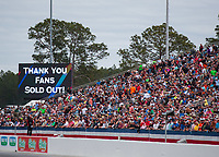 Mar 16, 2019; Gainesville, FL, USA; NHRA fans crowd the grandstands as the Jumbotron announces a sold out event during qualifying for the Gatornationals at Gainesville Raceway. Mandatory Credit: Mark J. Rebilas-USA TODAY Sports