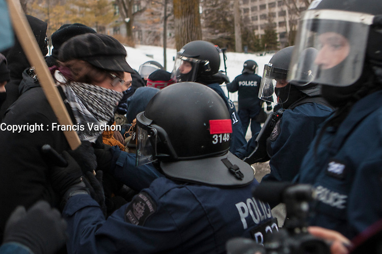 Protesters and police scuffle during a protest against austerity organized by the ASSE student group in Quebec city Thursday March 26, 2015.<br /> <br /> PHOTO :  Francis Vachon - Agence Quebec Presse