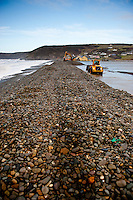 Tuesday 07 January 2014<br /> Pictured: Diggers work to clear the pebbles <br /> Re: Workers try to clear stones thrown over the road by the sea at Newgale, Pembrokeshire after has been battered by the wind and High Tides over the last few days