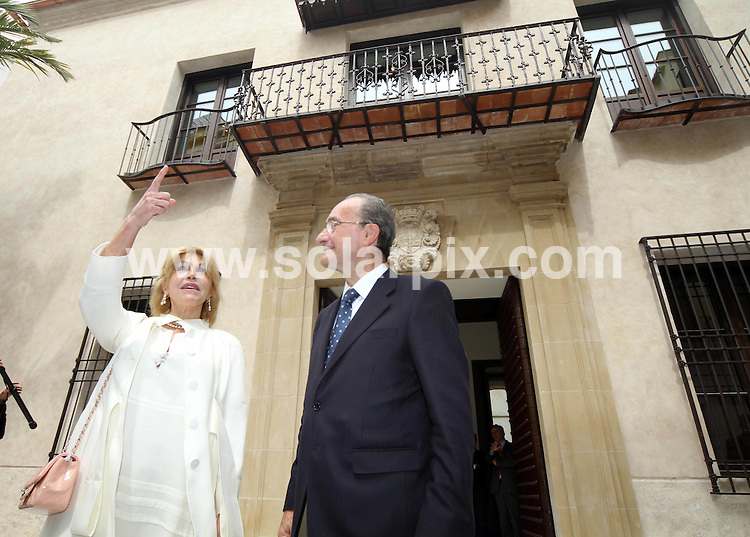 "**ALL ROUND PICTURES FROM SOLARPIX.COM**                                             **WORLDWIDE SYNDICATION RIGHTS EXCEPT SPAIN & SOUTH AMERICA - NO SYNDICATION IN SPAIN OR SOUTH AMERICA**                                                                                  Caption: .Spanish baroness Carmen Thyssen-Bornemisza widow of Baron Thyssen-Bornemisza, said at  the opening  presentation of the Malaga museum that the works on display in the new space, 230 were selected ""for their quality and closeness to Andalusia, although there are paintings that are not Andalusian such as those by Sorolla, Regoyos and Beruete."".The Baroness has loaned these works for free for a period of fifteen years but was confident that ""in no time"" she will reach an agreement to extend the agreement..Among the pieces that the public can see starting tomorrow, Carmen Cervera said there is an anonymous carving of Christ dated between 1230 and 1250 and a painting in which Guillermo Gómez Gil captured the Reding Fountain. ""I acquired the painting many years ago at an auction in London and it was one of my first Spanish works, "" she said.   .                                                                            .This pic: Thyssen-Bornemisza and Malaga mayor Francisco de la Torre outside the new Carmen Thyssen Museum in Malaga                                                                                            JOB REF: 13016       MPA       DATE: 23.03.2011                                                           **MUST CREDIT SOLARPIX.COM OR DOUBLE FEE WILL BE CHARGED**                                                                      **MUST AGREE FEE BEFORE ONLINE USAGE**                               **CALL US ON: +34 952 811 768 or LOW RATE FROM UK 0844 617 7637**"