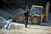 Pictured: A forensic officer and a digger operate at the site where Ben Needham disappeared from in Kos, Greece. Friday 14 October 2016<br />