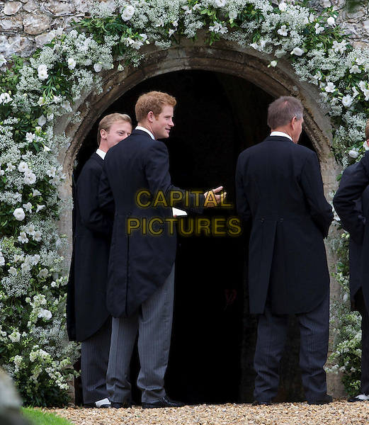 Prince Harry<br /> At the wedding of James Meade and Lady Laura Marsham at parish church of St Nicholas, Gayton, King's Lynn, England, UK, <br /> September 14th 2013.<br /> full length royal HRH black coat tailcoat tails suit waistcoat morning grey gray trousers back rear behind <br /> CAP/BF<br /> &copy;Bob Fidgeon/Capital Pictures
