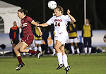 03 November 2010: Virginia's Colleen Flanagan (24) and Boston College's Victoria DiMartino (1). The Boston College Eagles defeated the Virginia Cavaliers 1-0 in an ACC Women's Soccer Tournament quarterfinal game at Koka Booth Stadium at WakeMed Soccer Park in Cary, NC.