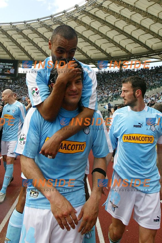 Roma 16/5/2004 Lazio Modena 2-1 Campionato Italiano Serie A 2003/2004 <br /> Fabio Liverani and Fernando Couto<br /> La Lazio festeggia, al termine della partita, la conquista della Coppa Italia avvenuta Mercoledi 12/5/2004 a Torino contro la Juventus. <br /> Lazio team celebrates, at the end of the championship match, Italy cup victory obtained on Wednesday, May 15 2004 against Juventus.  <br /> Photo Andrea Staccioli Insidefoto
