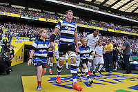 Stuart Hooper of Bath Rugby and Alistair Hargreaves of Saracens, mascots in hand, lead their teams out onto the field. Aviva Premiership Final, between Bath Rugby and Saracens on May 30, 2015 at Twickenham Stadium in London, England. Photo by: Patrick Khachfe / Onside Images