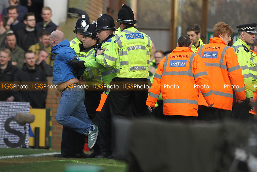 Police take away an Ipswich fan who tried to get on the pitch during Norwich City vs Ipswich Town, Sky Bet EFL Championship Football at Carrow Road on 26th February 2017