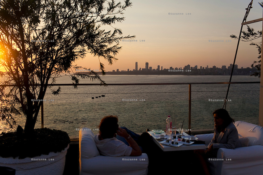 Views of the Arabian Sea from a roof top bar in a hotel at the Marine Drive, also known as The Queen's Necklace, Mumbai, India. Photo by Suzanne Lee
